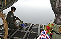 Wreath laying at sea (6643220631).jpg