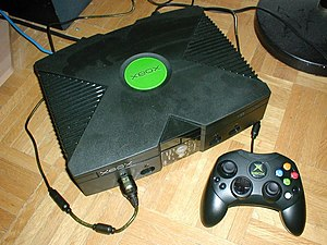 This is a picture of an XBOX, and its controller.