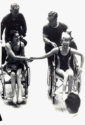 Australia at the Paralympics - Daphne Ceeney and Elizabeth Edmondson shake hands after Edmondson won gold and Ceeney silver in the 50 m prone swimming event in Tokyo at the 1964 Summer Paralympic Games.