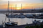 Yachts in Syracuse at sunset. Sicily, Italy.jpg