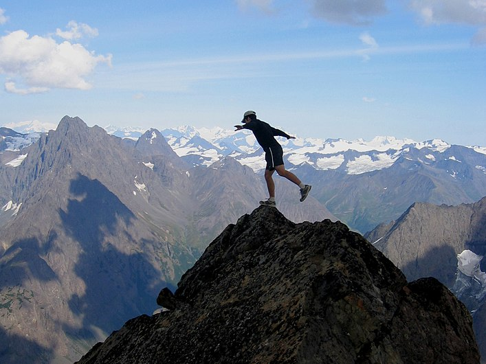 """Balancing on the Brink."" Eagle Peak summit, Chugach Mountains, Alaska (5434541912).jpg"