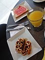 (a glass of orange juice bread with and jelly and a waffle).jpg