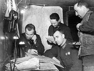 95th Rifle Division -  The command post of the 95th Rifle Division in Stalingrad. From left to right: the Division commander, Col. Gorishnii V.A., military commissar of Division Col. Vlasenko I.A. (sitting), Head of the 1st Dep. Maj.  Slutsky G.G., the Head of Division artillery, Lt. Col. Dalakishvili A.A. 1942