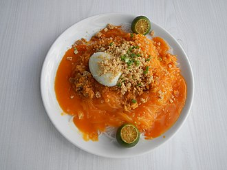 Fusion cuisine - Pancit palabok in Filipino cuisine, combines rice noodles and tofu from China with native smoked fish flakes in a shrimp sauce dyed bright orange with annatto seeds from Mexico and garnished with crushed chicharon from Spain. It is served spritzed with native calamansi.
