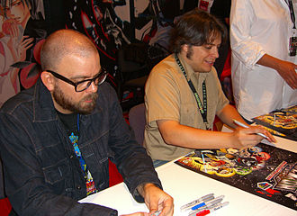 Voltron - Voltron comics creators Brian Smith and Jacob Chabot signing Voltron posters at the Viz Media booth at the 2011 New York Comic Con.