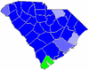 Blue counties were won by Thompson and green counties were won by McLane