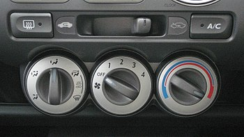 1st gen Honda Fit manual air conditioner console.jpg