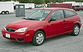 2007 Ford Focus SE (ZX3) in red, front left at Hershey 2019.jpg