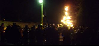 Cuddesdon - Cuddesdon villagers and students Christmas Carolling on the village green 16 December 2007