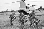 6 RAR soldiers disembark from a US Army Chinook helicopter during a 1966 combat operation in South Vietnam.jpg