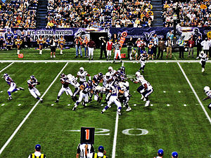 2007 NFL season - Adrian Peterson of Minnesota rushes against San Diego in week 9, on his way to a record 296 rushing yards in a game