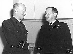 Informal half portrait of two smiling men in dark military uniforms