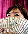 A Korean woman with hand fan.jpg