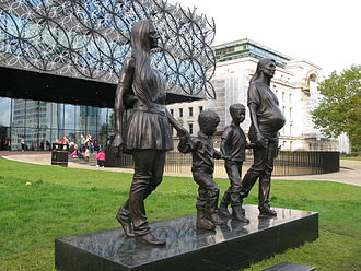 Ikon Gallery - A Real Birmingham Family by Gillian Wearing, with the Library of Birmingham (left) and Baskerville House in the background