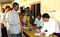 A blind voter standing in a queue for casting his vote at a polling booth, at Satsang Middle School, Chutia, in Ranchi, Jharkhand, during the 2nd Phase General Elections-2009 on April 23, 2009.jpg