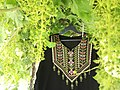 A hand-embroidered Palestinian dress.jpg
