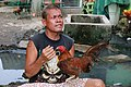 A man and his rooster in talisay, cebu, philippines.jpg