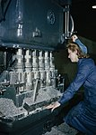 A woman war worker machining a cylinder block for a Rolls Royce aero engine. TR1141.jpg
