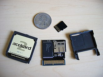 Larger flashcart, shown with small card and U.S. quarter for size