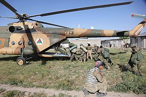 201st Corps (Afghanistan) - Soldiers of the 1st Kandak, 4th Brigade, 201st Corps board an Afghan Air Force Mi-17 helicopter after executing a clearing operation near Hesarak, Nangarhar province, 17 May 2013