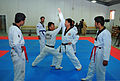Afghan National Police (ANP) students learn taekwondo from South Korean national police taekwondo masters at the ANP Training Center supported by the South Korea Provincial Reconstruction Team for Parwan 120127-N-VN372-049.jpg