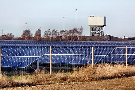 Colliery behind a solar farm in North Yorkshire in 2017 Alternative power (geograph 5647191).jpg