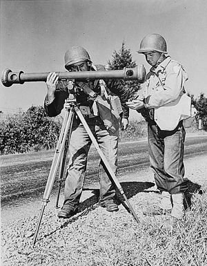 Coincidence rangefinder - American soldiers using a coincidence rangefinder with its distinctive single eyepiece during army maneuvers in the 1940s.
