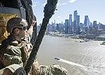 An EODMU 6 technician flies along the Manhattan skyline in an MH-60S Seahawk assigned to HSC-9 during Fleet Week New York 2019.jpg