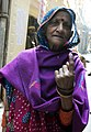 An Elderly woman voter showing mark of indelible ink after casting her vote, at a polling booth, during the Delhi Assembly Election, in Delhi on February 07, 2015.jpg