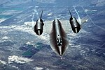 "An air-to-air overhead front view of an SR-71A strategic reconnaissance aircraft. The SR-71 is unofficially known as the ""Blackbird."" DF-ST-89-06288.jpg"