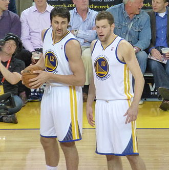David Lee (basketball) - Lee (right) with Andrew Bogut in March 2013