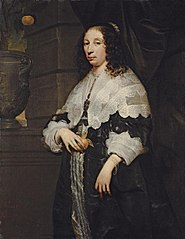 Portrait of a lady holding an orange