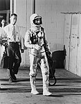 Astronaut Scott Carpenter leaving White Room for launch site to begin Mercury-Atlas 7 (MA-7) mission.jpg