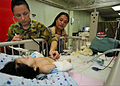 Australian Army Capt. Kerry McKinnell, top left, checks the vitals of a four-month-old Indonesian girl who had surgery to fix her cleft lip aboard Military Sealift Command hospital ship USNS Mercy (T-AH 19) 120602-O-ZZ999-010.jpg