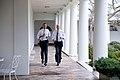 Barack Obama and Joe Biden running in the Colonnade of the White House, February 2014 (13898117298).jpg