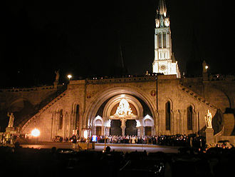 Sanctuary of Our Lady of Lourdes - Rosary Basilica at night, looking across Rosary Square during the Torchlight Procession