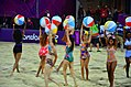 Beach balls being waved by the dancers at the Olympic beach volleyball arena at London 2012 (7725438092).jpg