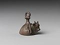 Bell with head of a bovine wearing a yoke ending in uraei MET DP238930.jpg
