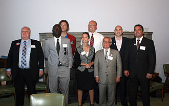 Keith Cole (performance artist) - Cole at a mayoral debate in 2010. He is in the second row, first from left