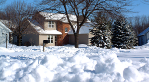 Heavy snow covers homes and streets in a resid...