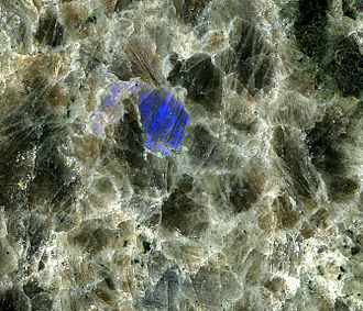 "Nain, Newfoundland and Labrador - Anorthosite, marketed as ""Blue Eyes Granite,"" from the Ten Mile Bay Quarry, near Nain. Every crystal will flash bright blue when tilted at the correct angle in the light, an optical effect called ""labradorescence""."