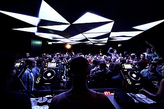 Nightclub - Club DJ using digital CDJ players for mixing music (Munich, 2010s)