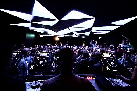 Club DJ using digital CDJ players for mixing music (Munich, 2010s) Bob Beaman Nightclub Munich 1.jpg