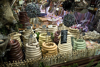 Belgian cuisine - Varieties of coiled boudin (blood sausage) on sale at a Belgian Christmas Market
