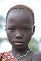 Boy, Mursi Tribe, Ethiopia (15549743732).jpg