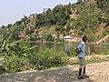 Boy on Shore of Lake Kivu - DR Congo at Rear - Cyangugu (Rusizi) - Rwanda (9009862328).jpg