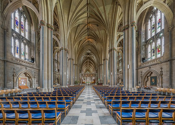 "The ""lierne"" vaulting of the choir and tower can be seen here from Street's nave, with clustered columns and Purbeck marble shafts. Bristol Cathedral Nave looking east, Bristol, UK - Diliff.jpg"