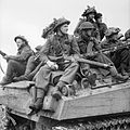 British infantry ride on Sherman tanks in Holland, 24 September 1944. B10287.jpg