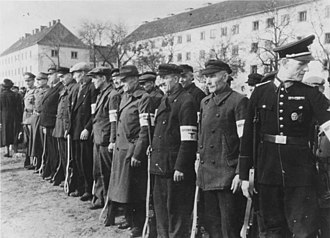 Volkssturm - 21 October 1944. An SS Propaganda Company photograph of Volkssturm; only the men on the far left and far right end of the line appear to be uniformed members.