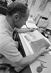 Buzz Aldrin reviews maps of the area they will pass over after LM launch from the lunar surface.jpg
